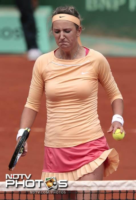 World No. 1 Victoria Azarenka reacts after she lost against Slovakia's Dominika Cibulkova their Women's Singles 4th Round tennis match of the French Open at the Roland Garros stadium in Paris. (AFP Photo)