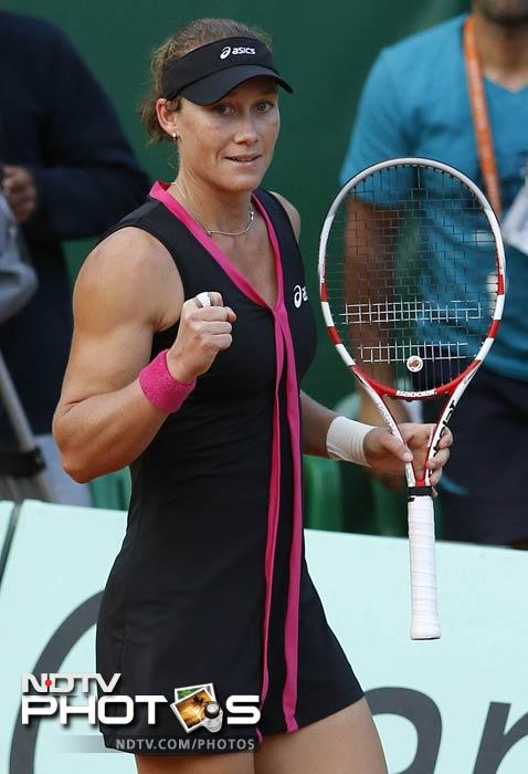 Australia's Samantha Stosur celebrates after winning against US Sloane Stephens their Women's Singles 4th Round tennis match of the French Open at the Roland Garros stadium in Paris. (AFP Photo)