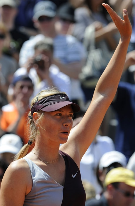 Russia's Maria Sharapova reacts after she defeated Belgium's Kirsten Flipkens during their women's second round match in the French Open. (AFP photo)