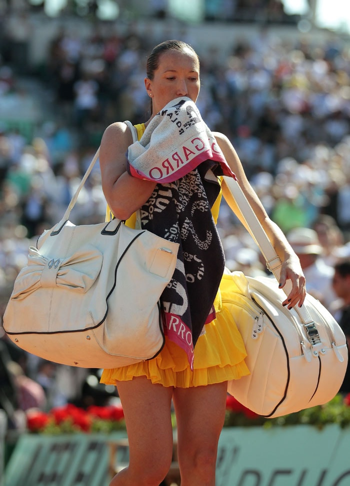 Serbia's Jelena Jankovic leaves the court after losing her women's semi-final match. (AFP PHOTO)