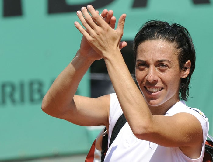 Italy's Francesca Schiavone reacts during her women's semi-final match against Russia's Elena Dementieva. Schiavone became the first Italian woman to reach a Grand Slam final when Dementieva retired at the end of the first set.(AFP PHOTO)