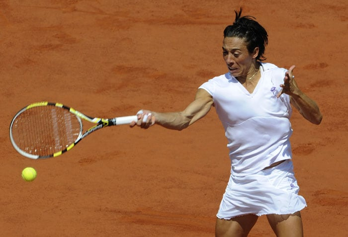 Italy's Francesca Schiavone plays a return against Russia's Elena Dementieva.The Italian won the opener 7-6 (7/3) when a tearful Dementieva quit because of an injury. (AFP PHOTO)
