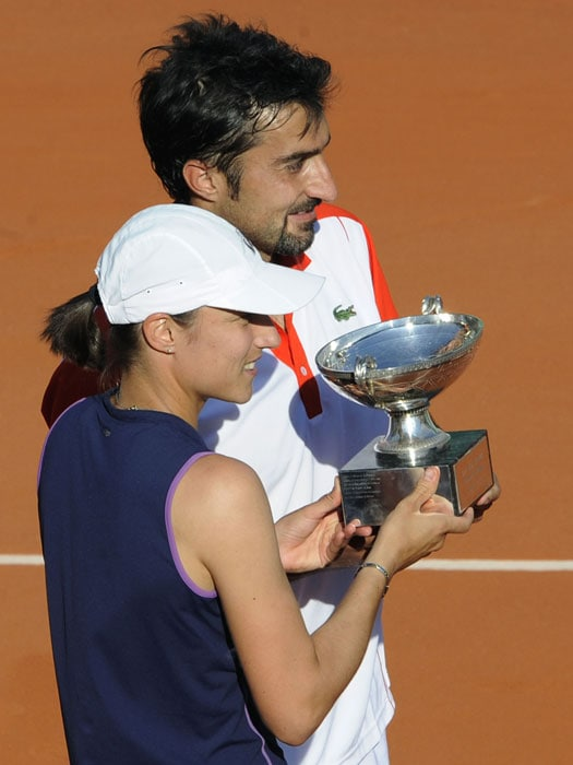 Serbia's Nenad Zimonjic and Slovenia's Katarina Srebotnik pose with their trophy after they won the mixed double final match against Kazakhstan's Yaroslava Shvedova and Austria's Julian Knowle.(AFP PHOTO)
