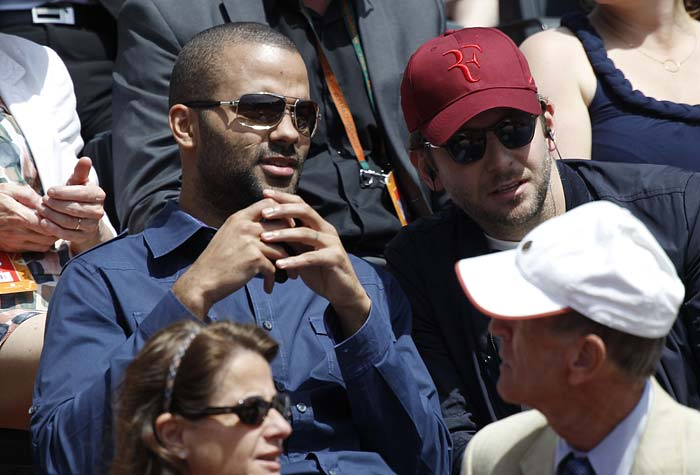 French basketball player Tony Parker (L) attends the game the men's fourth round match between Switzerland's Roger Federer and Stanislas Wawrinka in the French Open tennis championship at the Roland Garros stadium in Paris. (AFP PHOTO)
