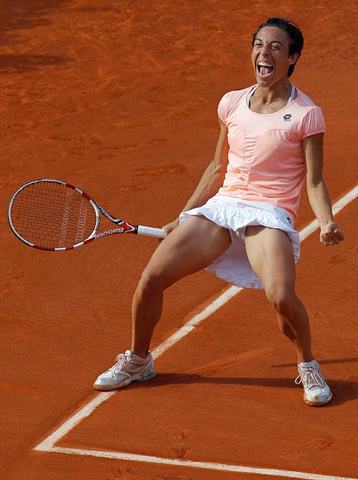 Italy's Francesca Schiavone celebrates after winning against Serbia's Jelena Jankovic during their women's fourth round match in the French Open tennis championship at the Roland Garros stadium. (AFP PHOTO)