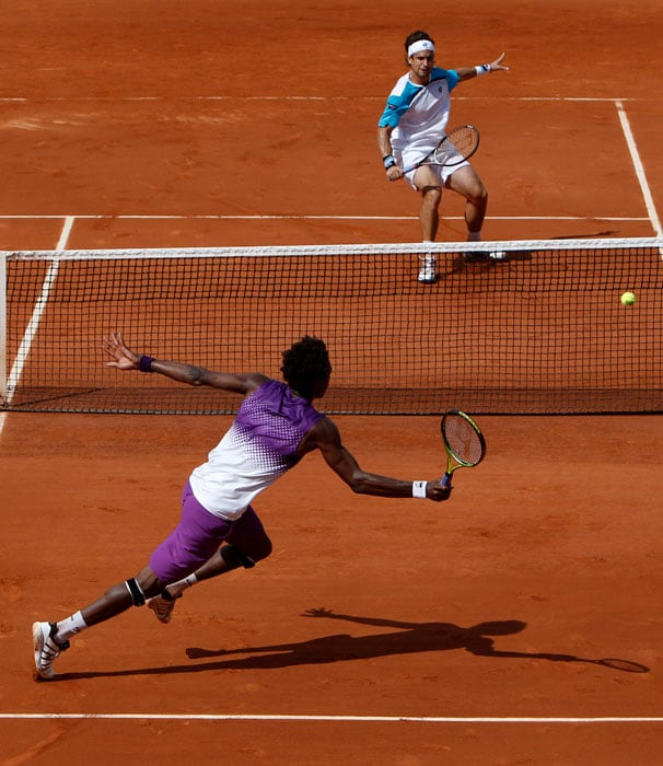 It was an even contest between France's Gael Monfils and Spain's David Ferrer but in the end the Frenchman prevailed at the French Open tennis tournament at the Roland Garros stadium in Paris. (AP Photo)