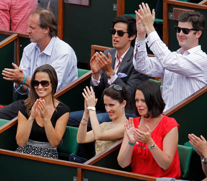 The Soderling-Simon match had a royal spectator as Pippa Middleton, sister of Kate, Duchess of Cambridge (bottom left) was in attendance to watch the fourth round match of the French Open tennis tournament at the Roland Garros stadium in Paris. (AP Photo)