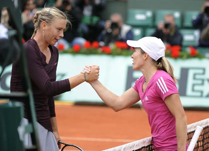 No.12 seed Maria Sharapova was upset by Justine Henin in 3 sets 6-2, 3-6, 6-3 in the 3rd round of the tournament. (AFP PHOTO)