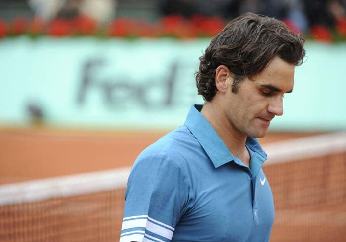World Number 1 and defending champion Roger Federer was ousted from the tournament when he lost to Swede Robin Soderling 3-6, 6-3, 7-5, 6-4 in the quarterfinals.(AFP PHOTO)