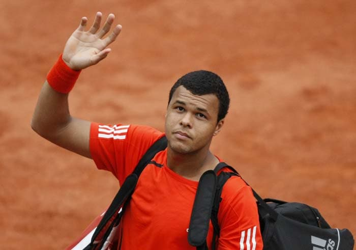 French No.8 seed Jo-Wilfried Tsonga lost to No.11 seeded Russian Mikhail Youzhny after Tsonga forfeited the match due to injury in the 4th round. (AP PHOTO)
