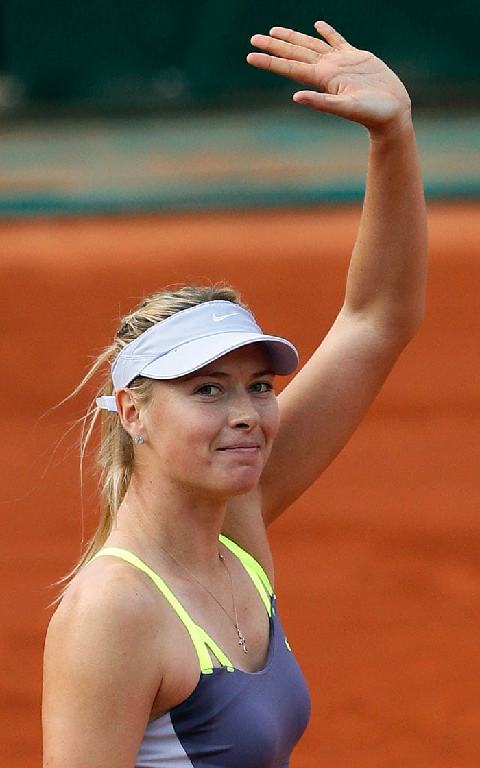 Defending champion Maria Sharapova dropped just eight points on serve to ease into the French Open second round on Monday with a 6-2, 6-1 win over Taiwan's Hsieh Su-Wei.