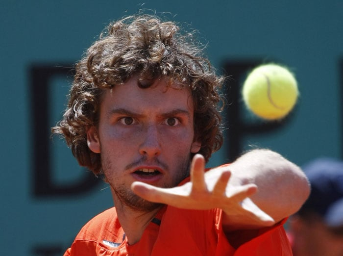 Latvia's Ernests Gulbis returns the ball to France's Julien Benetteau during their first round match of the French Open at the Roland Garros stadium in Paris. (AP Photo)
