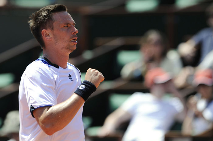 Sweden's Robin Soderling reacts during the men's first round match in the French Open at the Roland Garros stadium in Paris. (AFP Photo)