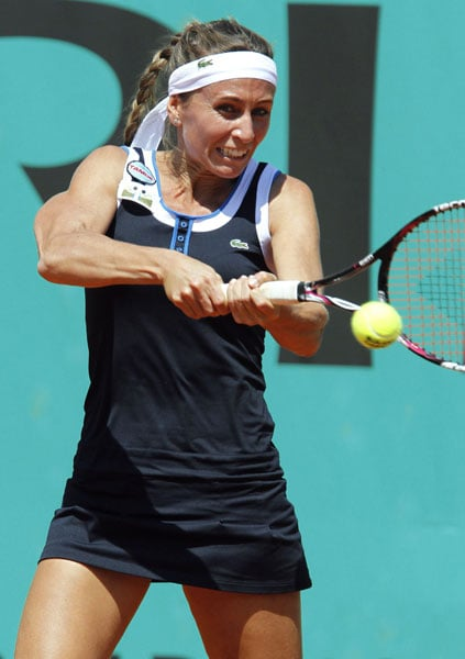Gisela Dulko of Argentina plays a return to Victoria Azarenka of Belarus during their first round match in the French Open at the Roland Garros stadium in Paris. (AFP Photo)