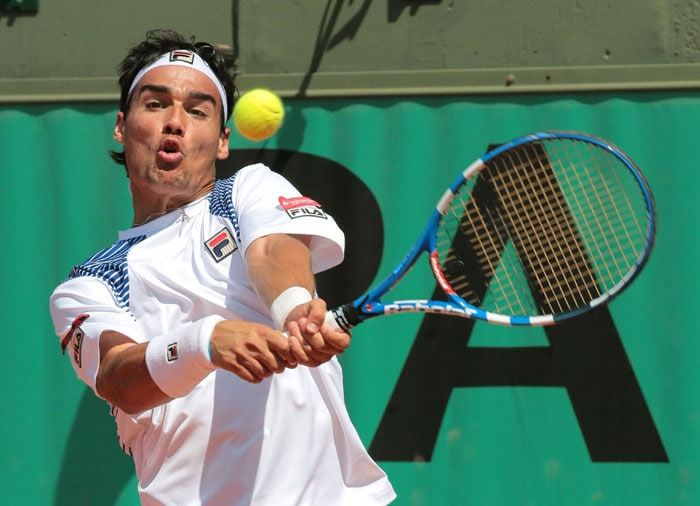 Italy's Fabio Fognini returns the ball to Chile's Nicolas Massu during the men's first round in the French Open at the Roland Garros stadium in Paris. (AFP Photo)