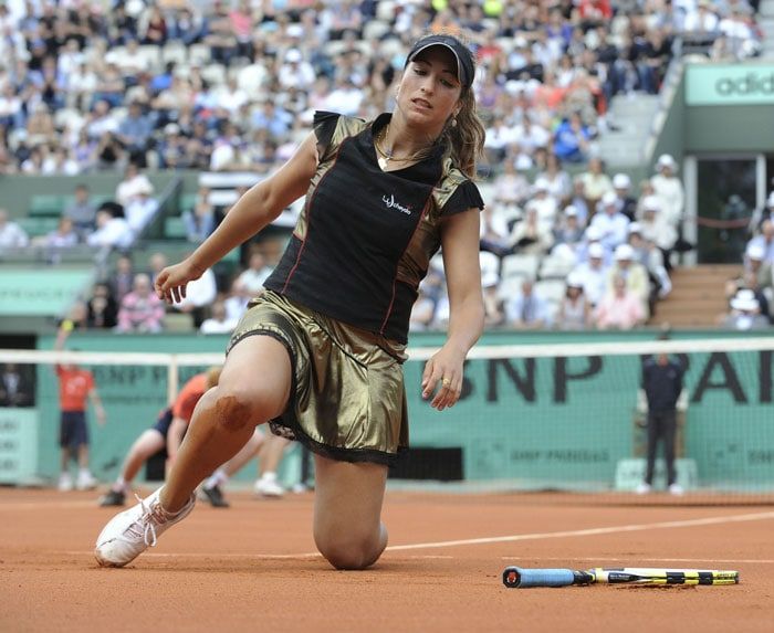 France's Aravane Rezai gets up after a fall during her women's second round match against Germany's Angelique Kerber in the French Open at the Roland Garros stadium in Paris. (AFP Photo)