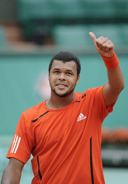 France's Jo-Wilfried Tsonga celebrates a point against France's Josselin Ouanna during their men's second round match in the French Open at the Roland Garros stadium in Paris. (AFP Photo)
