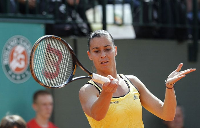 Italy's Flavia Pennetta plays a return to Italy's Roberta Vinci during their women's second round match in the French Open at the Roland Garros stadium in Paris. (AFP Photo)