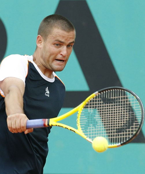 Russia's Mikhail Youzhny plays a return to Slovakia's Lukas Lacko during their men's second round match in the French Open at the Roland Garros stadium in Paris. (AFP Photo)