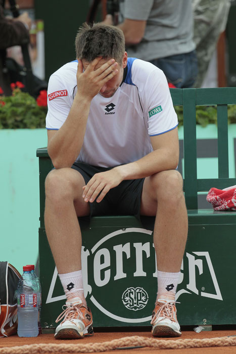 Robin Soderling looks on after losing against Rafael Nadal during the men's final match in the French Open at the Roland Garros stadium in Paris. (AFP Photo)