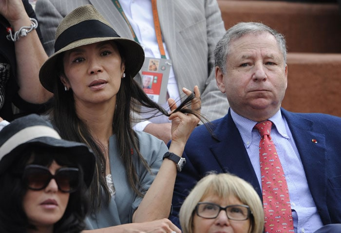 FIA president Jean Todt and actress Michelle Yeoh watch the men's final match between Robin Soderling and Rafael Nadal in the French Open at the Roland Garros stadium in Paris. (AFP Photo)