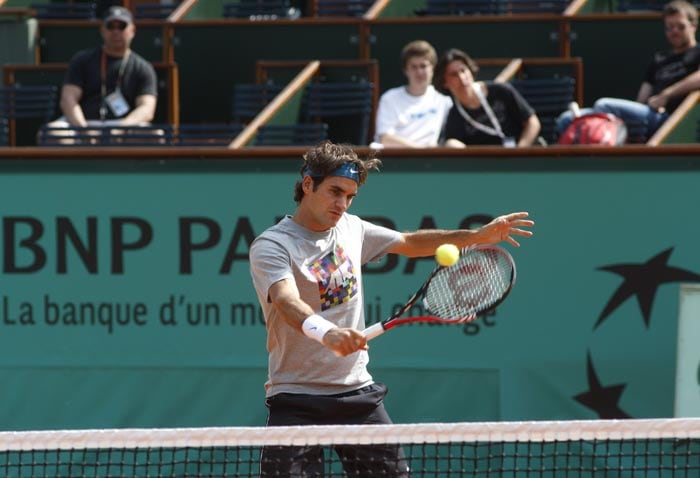 Defending champion Roger Federer returns the ball during a training session at the Roland Garros stadium in Paris. (AP Photo)