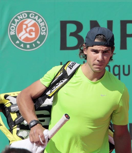 Rafael Nadal arrives on the centre court for a training session at Roland Garros tennis stadium in Paris. (AFP Photo)