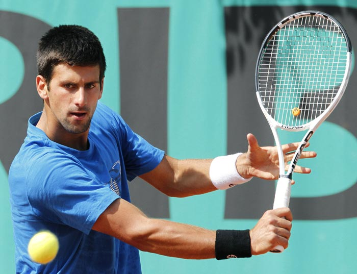 Serbia's Novak Djokovic plays a return during a practice session at the French Open tennis championship at the Roland Garros stadium in Paris. (AFP Photo)