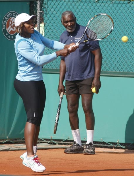 USA's Serena Williams trains at the Roland Garros stadium while her father Richard looks on in Paris. (AP Photo)