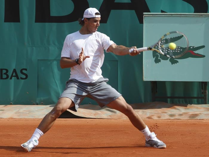 Spain's Rafael Nadal returns the ball as he trains at the Roland Garros stadium in Paris on the eve of the French open tennis tournament. (AP Photo)