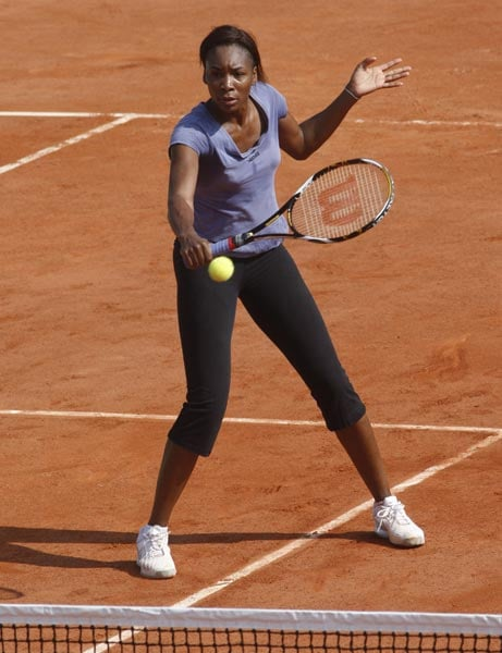 USA's Venus Williams trains at the Roland Garros stadium in Paris on the eve of the French open tennis tournament. (AP Photo)