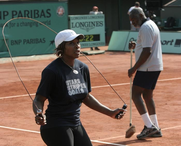 USA's Serena Wlliams exercises during a training session at the Roland Garros stadium in Paris on the eve of the French Open tennis tournament. (AP Photo)