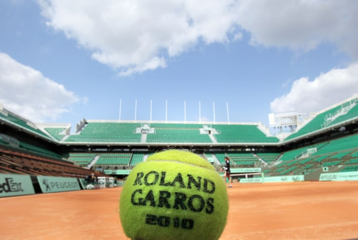 """An official ball of 2010's French Open tennis tournament is displayed on the central court """"Philippe Chatrier"""" of Roland Garros' stadium. The Roland Garros event will run from May 23 to June 6, 2010. (AFP Photo)"""