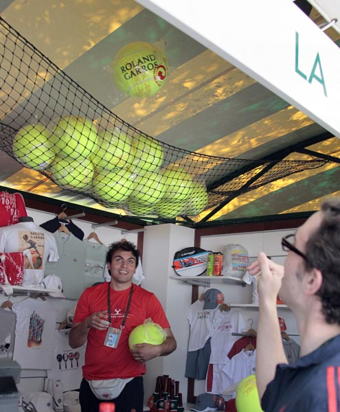 Employees prepare an official Roland Garros products store in Paris at Roland Garros stadium. (AFP Photo)