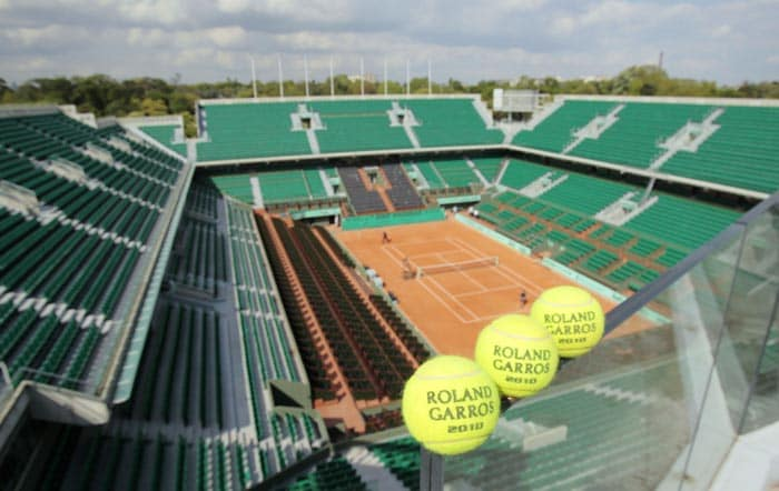 """Official balls of 2010's French Open tennis tournament are displayed on the central court """"Philippe Chatrier"""" of Roland Garros' stadium in Paris. (AFP Photo)"""