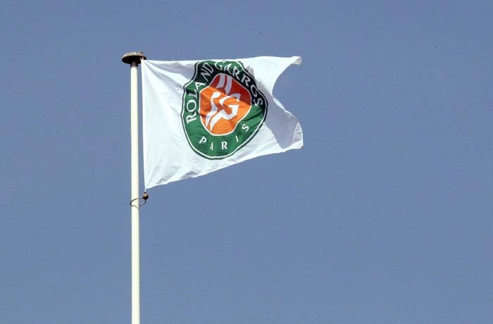 A flag is pictured over the centre court at the Roland Garros tennis stadium in Paris. (AFP Photo)
