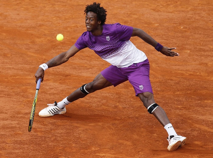 Gael Monfils of France returns against Roger Federer of Switzerland in the quarterfinal match of the French Open at the Roland Garros stadium in Paris. (AP Photo)