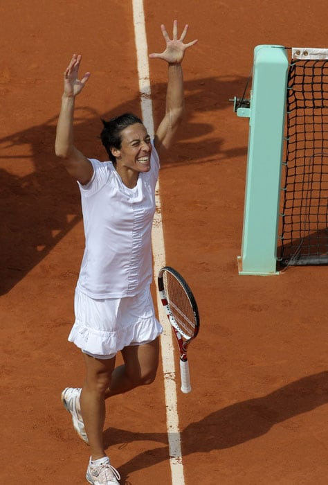 Italy's Francesca Schiavone reacts after defeating Russia's Anastasia Pavlyuchenkova in their quarterfinal match of the French Open tennis tournament at the Roland Garros stadium in Paris. (AP Photo)