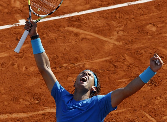 Spain's Rafael Nadal reacts as he defeats Sweden's Robin Soderling during their quarterfinal match of the French Open tennis tournament, at the Roland Garros stadium in Paris. Nadal won 6-4, 6-1, 7-6. (AP Photo)