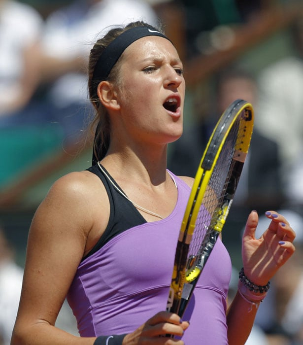 Belarus's Victoria Azarenka reacts after a point against China's Li Na during their women's fourth quarterfinal match in the French Open tennis championship at the Roland Garros stadium in Paris. (AFP Photo)