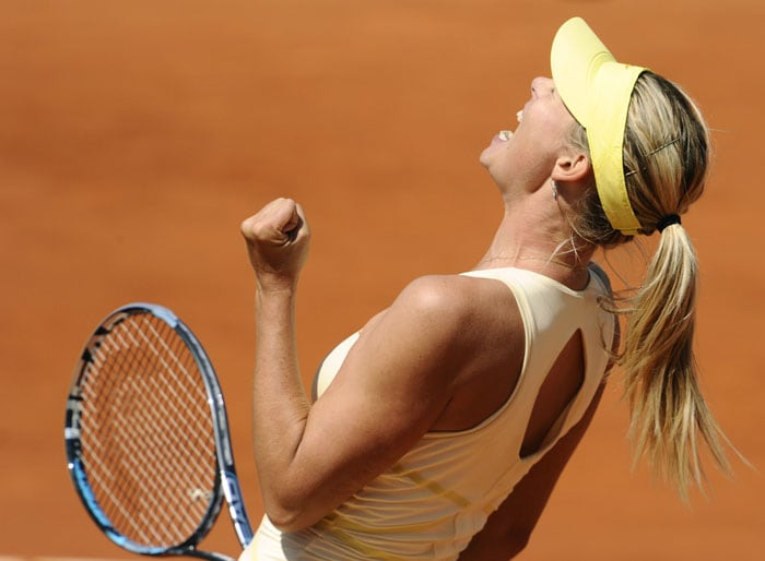 Russia's Maria Sharapova reacts after winning over Germany's Andrea Petkovic during their women's quarterfinal in the French Open tennis championship at the Roland Garros stadium in Paris. (AFP Photo)