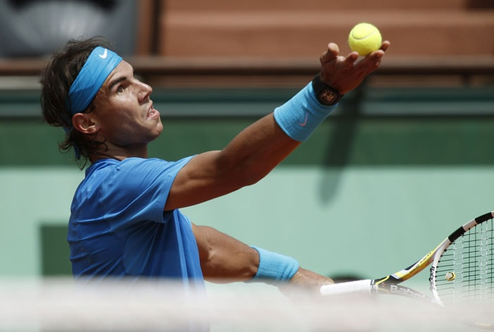 Spain's Rafael Nadal hits a return to Croatia's Antonio Veic during their Men's third round match in the French Open tennis championship at the Roland Garros stadium in Paris. (AFP Photo)