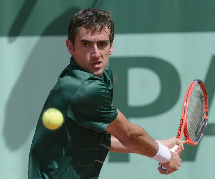Croatia's Marin Cilic hits a return to Spain's Ruben Ramirez Hidalgo during their men's first round match in the French Open tennis championship at the Roland Garros stadium in Paris. (AFP Photo)