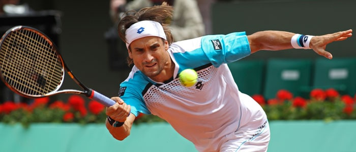 Spain's David Ferrer returns the ball to Jarkko Nieminen of Finland in the first round match of the French open tennis tournament at Roland Garros stadium in Paris. Ferrer won in three sets 6-3, 6-3, 6-1. (AP Photo)