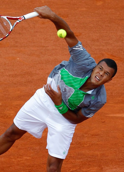 France's Jo-Wilfried Tsonga serves to Czech Republic's Jan Hajek during their men's first round match in the French Open tennis championship at the Roland Garros stadium in Paris. (AFP Photo)