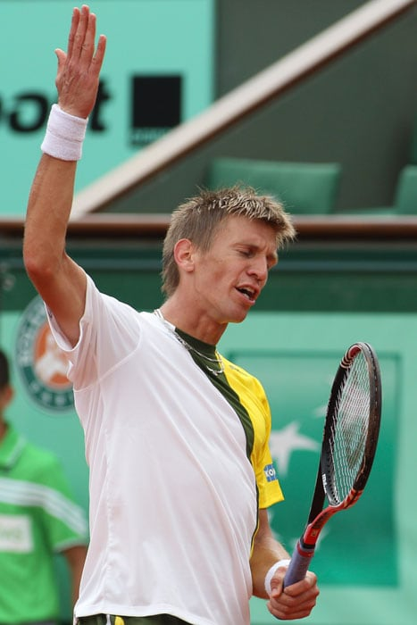 Jarkko Nieminen of Finland gestures in his match against David Ferrer of Spain in the first round match of the French open tennis tournament at Roland Garros stadium in Paris. Ferrer won in three sets 6-3, 6-3, 6-1. (AP Photo)