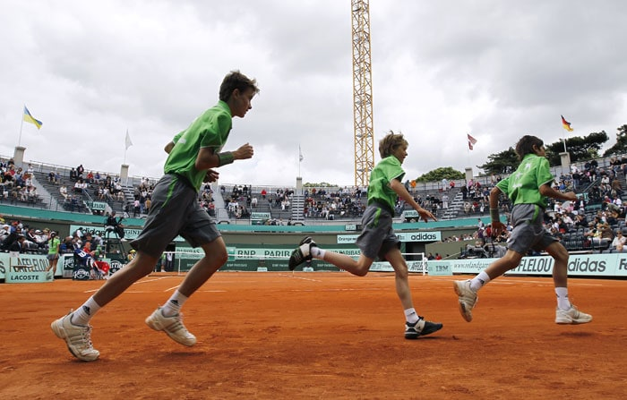The French Open had some players just do their custom duty of steamrolling their opponents, but the day also had its share of upsets. Most significant of these upsets however was the demise of the World No. 2 Kim Clijsters. (AFP Photo)