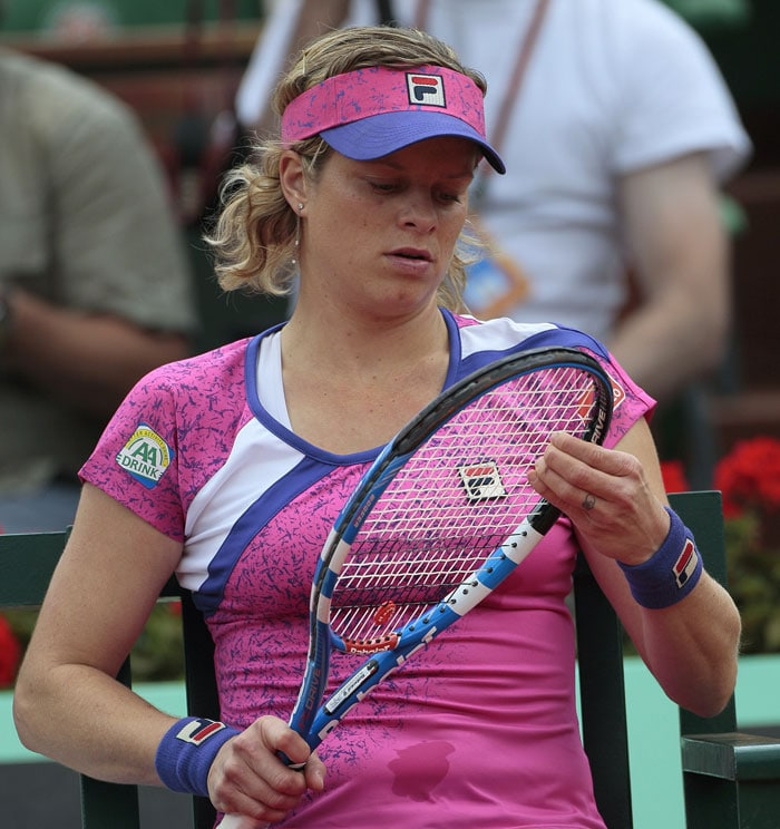 World No. 2 Kim Clijsters crashed to a defeat against Arantxa Rus of the Netherlands. The Belgian's defeat came as the most significant upset so far. (AFP Photo)