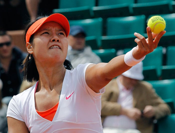 Australian Open finalist China's Li Na registered a straight sets victory against Spain's Silvia Soler Espinosa. (AFP Photo)