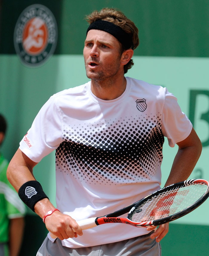 Mardy Fish had a rather easy encounter with Netherlands' Robin Haase as he won in straight sets. (AFP Photo)